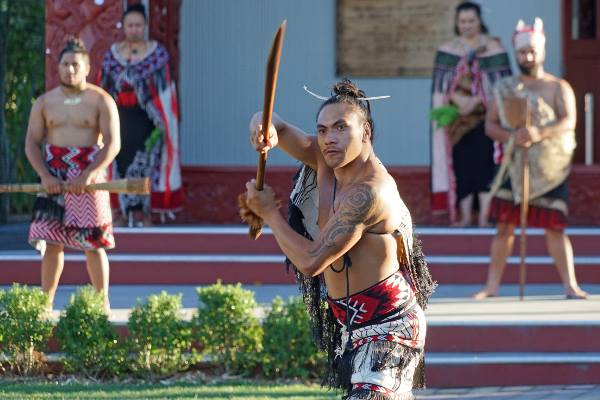 Maori warrior of New Zealand shows off his skills in a festival.